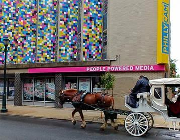 front exterior of PhillyCAM with passing horse drawn carriage